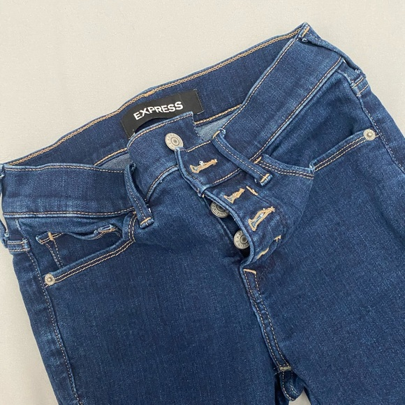 Express stretch mid rise jeans